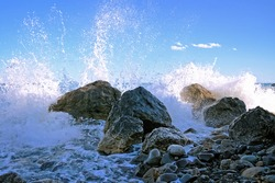 Sea surf with stones and water splashes