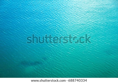 Sea surface aerial view. Beautiful blue ocean as background #688740334