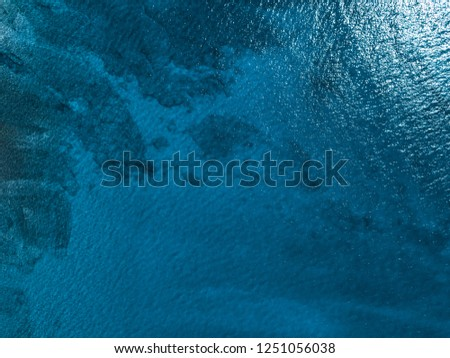 Sea surface arial view with visible coral reef