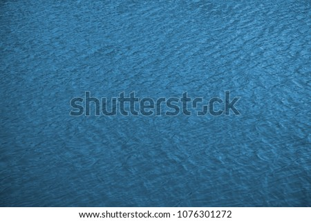Sea surface with small waves, aerial view in blue and turquoise color tones