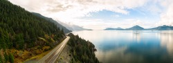 Sea to Sky Hwy in Howe Sound near Squamish, British Columbia, Canada. Aerial panoramic View. Beautiful Sunny and Cloudy Morning Sky.