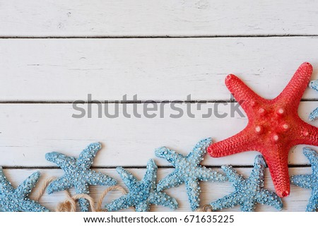 Sea travel frame decor with seashells and rope over wooden background #671635225