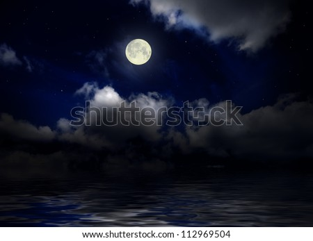 Sea under night sky with moon - stock photo