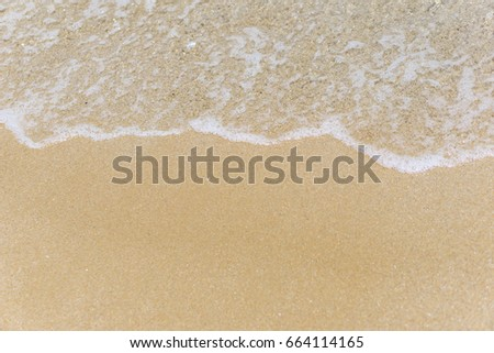 Sea view early summer with light waves, sunlight reflection, turquoise waters and fine yellow sand on the Bulgarian beach.  #664114165