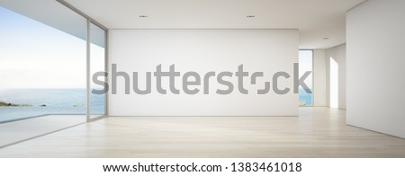 Sea view empty large living room of luxury summer beach house with swimming pool near wooden terrace. Big white wall background in vacation home or holiday villa. Hotel interior 3d illustration. Сток-фото ©