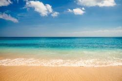 Sea view from tropical beach with sunny sky. Summer paradise beach of Bali island. Tropical shore. Tropical sea in Bali. Exotic summer beach with clouds on horizon. Ocean beach relax, outdoor travel