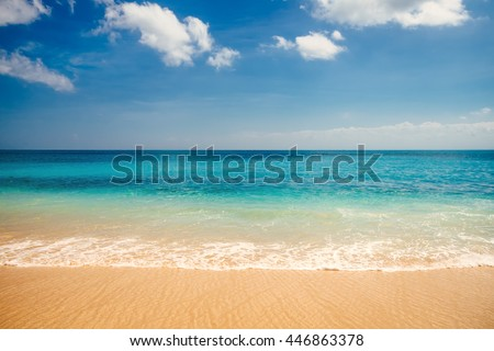 Shutterstock Sea view from tropical beach with sunny sky. Summer paradise beach of Bali island. Tropical shore. Tropical sea in Bali. Exotic summer beach with clouds on horizon. Ocean beach relax, outdoor travel