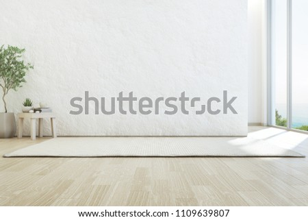 Sea view living room of luxury summer beach house with glass window and wooden floor. Empty rough white concrete wall background in vacation home or holiday villa. Hotel interior 3d illustration.
