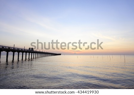 Sea view on morning time before sunrise with silhouette fishing pier on foreground,Close up,select focus with shallow depth of field:ideal use for background. #434419930