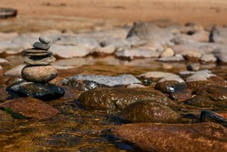 sea view with boulders and small stones stacked on top of each other . High quality photo
