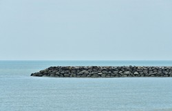 sea wall built in the sea to protect against the waves made from big stone