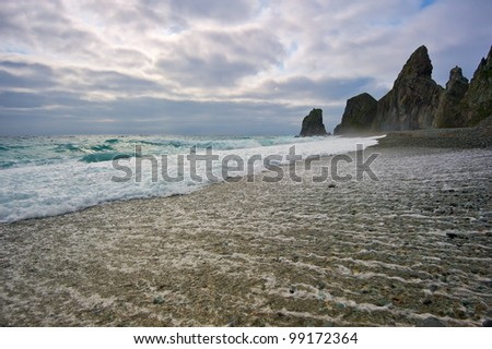 Sea water is flowing from the shore in the stormy sea. Japan Sea.