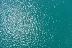 sea water smooth surface, ocean reflection sun, view above water 40 meter