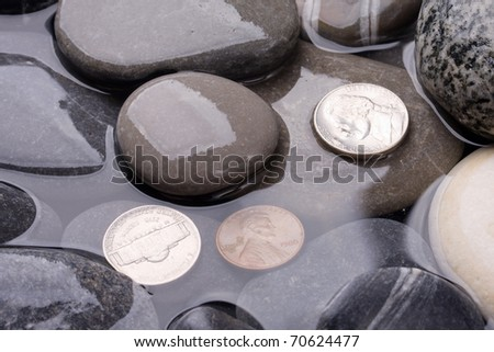 Sea water stones and money