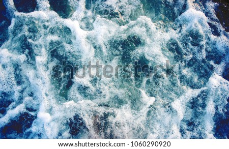 Sea water with foamy wave. Tropical islands boat travel. Cruise ship trail. Azure ocean surface top view. Big ship foamy trail. Motor boat tail on seawater. Marine travel banner template