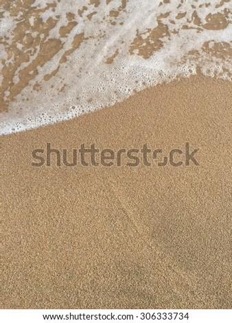 Sea wave and sand beach #306333734