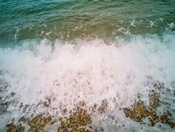 sea wave brakes on the beach