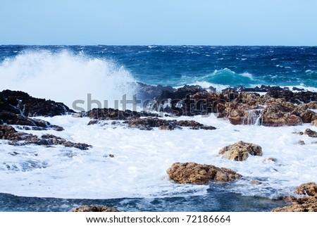 Sea wave breaking against coast  rock. Mediterranean