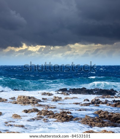 Sea wave breaking against coast  rock. Mediterranean area