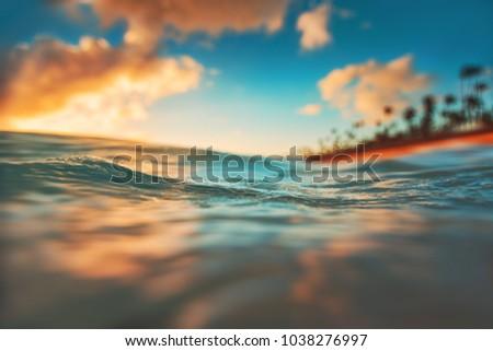 Sea wave close up, low angle view, sunrsie shot