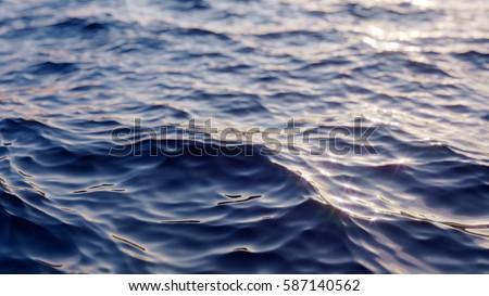Sea wave close up, low angle view, sunrsie shot #587140562