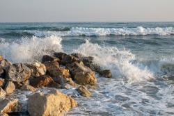 sea wave in rocks on shore
