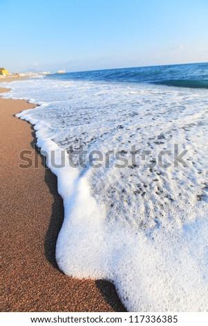 Sea wave on summer beach. Travel
