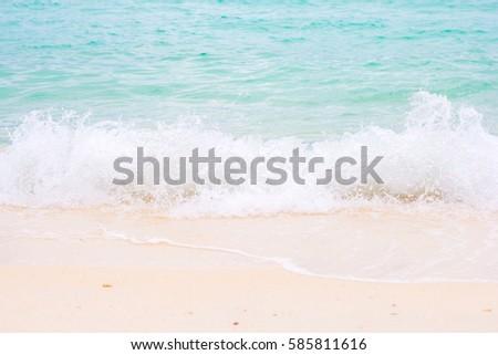 Sea wave on white sand beach. #585811616