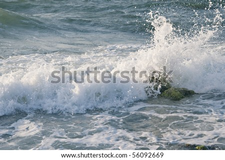 Sea wave rolling on the coast rocks #56092669