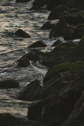 Sea wave swash the rocks