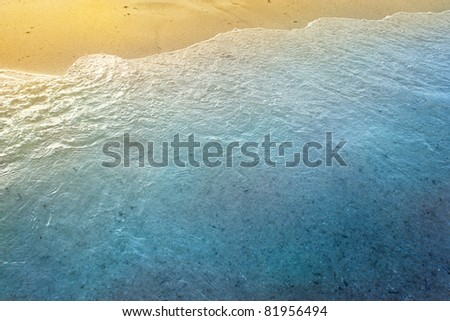 Sea waves background with golden sand and foam ocean water
