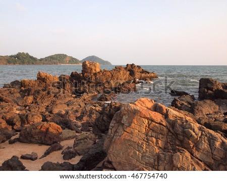 Sea waves crashing against the rocks #467754740