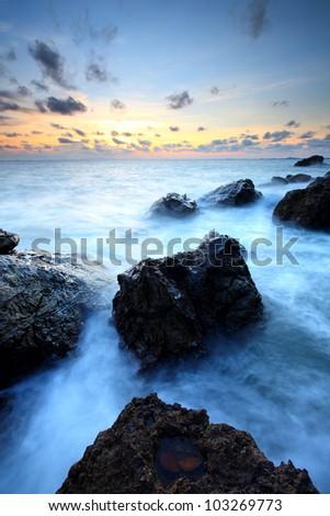 Sea waves  impact rock on the beach, Thailand