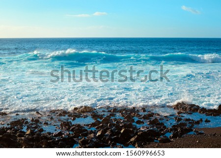Sea waves on the coast of the island at sunset landscape. Seaside resort.