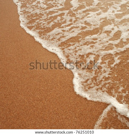 Sea waves on the sand