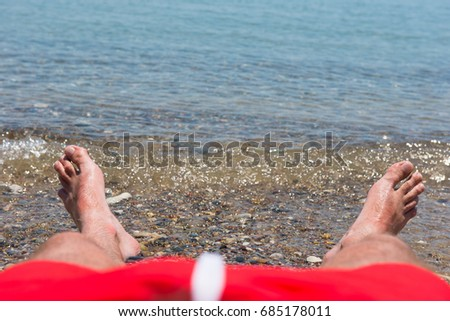 Hairy men walking beach