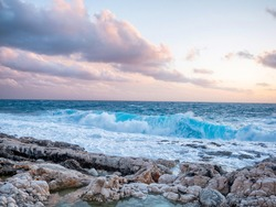 sea with waves and sky with clouds in the afternoon