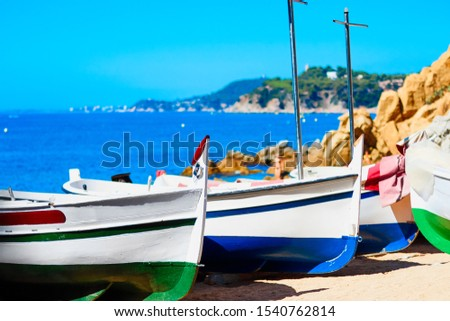 Sea. Wooden boats on the beach on a summer day. Seaside resort.