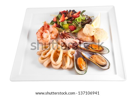 Seafood and salad isolated on white