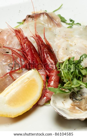 seafood appetizer with oyster, shrimp and arugula