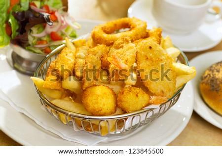 Seafood Basket with crumbed fish,calamari,scollop,prawn with potato chips