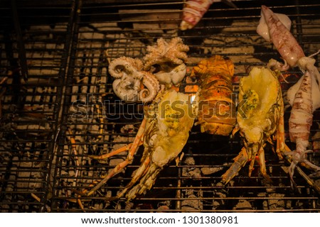 Seafood BBQ on grille. The picture refer to BBQ party.