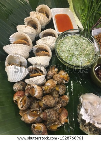 Seafood, clams and dipping sauce, spicy and sour taste