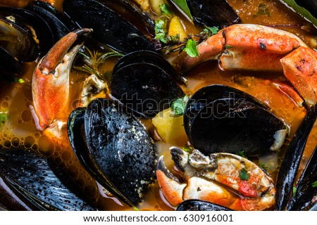 Seafood. Close up of seafood shellfish mussels crabs soup. Mariscal or paila marina #630916001