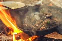 Seafood cooked on a campfire.