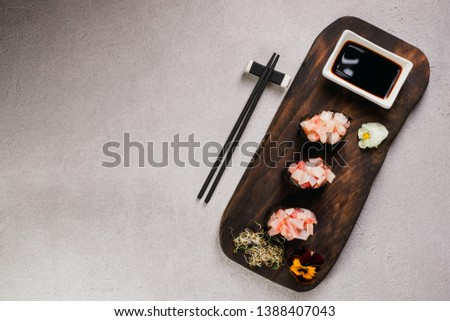Seafood delicatessen gunkan maki sushi rolls on wooden plate. Deluxe restaurant menu. Luxury lifestyle, expensive food
