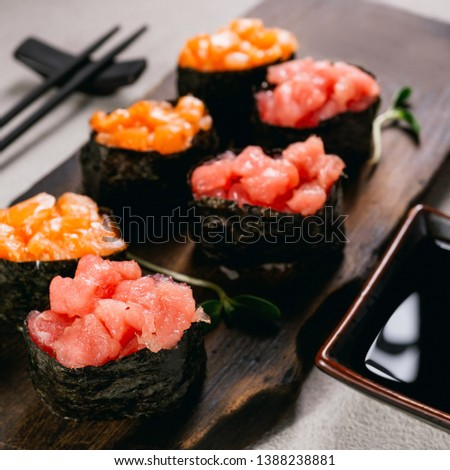 Seafood delicatessen gunkan maki sushi rolls on wooden plate. Different gourmet snacks. Luxury lifestyle, expensive food, restaurant menu