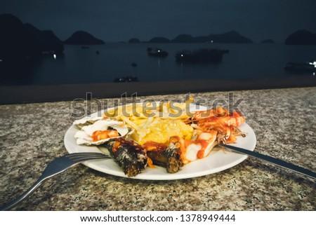 seafood dinner at restaurant to the sea. Vietnam ha long Bay night, nighttime, tonight #1378949444