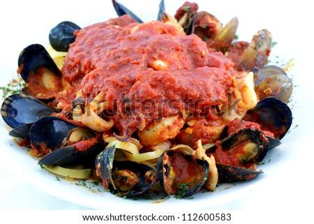 Seafood Fettuccine - Fettuccine pasta, sauce, fresh calamari, mussels, shrimp and clams.