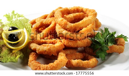 Deep-fried Squid Dressed with Salad Leaves, Parsley, Olives and Lemon ...